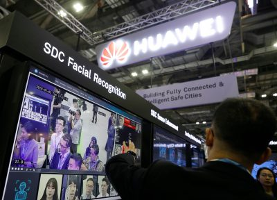 A Huawei employee showcases their facial recognition technology at their booth at Interpol World in Singapore, 2 July 2019 (Reuters/Edgar Su).