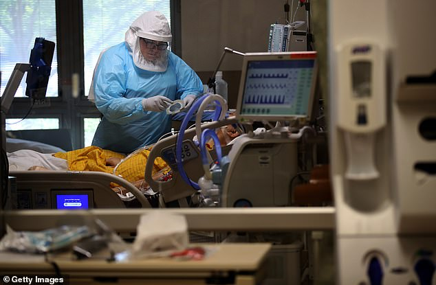 A nurse wears personal protective equipment (PPE) as she cares for a coronavirus COVID-19 patient in the intensive care unit at Regional Medical Center on May 21 in San Jose, California