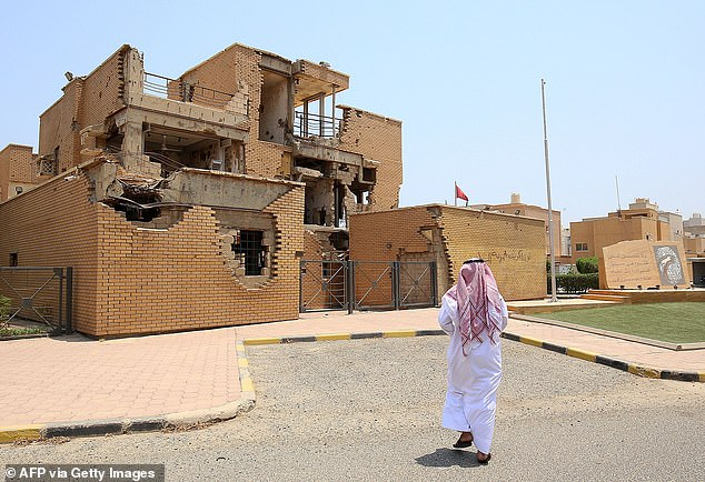 KUWAIT CITY, KUWAIT: A man walks pastal-Qurain Martyr's Museum earlier this week as blistering temperatures reached 129.2F (54C)