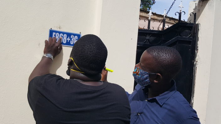 Bakary Suso (L) and Alieu Sowe, (R) are putting up the signs themselves