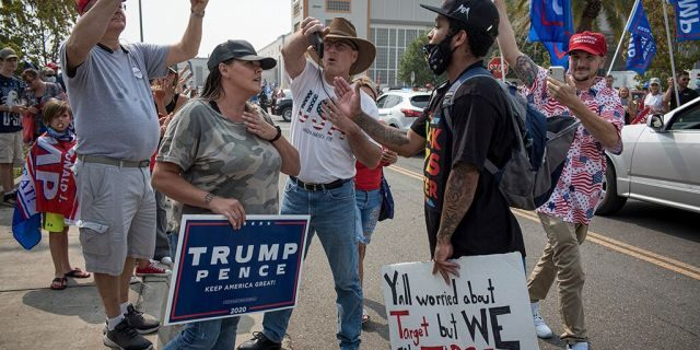 Supporters of U.S. President Donald Trump and a Black Lives Matter demonstrator rally at Sacramento McClellan Airport in Sacramento, California, U.S., on Monday, Sept. 14, 2020. David Paul Morris/Bloomberg via Getty Images