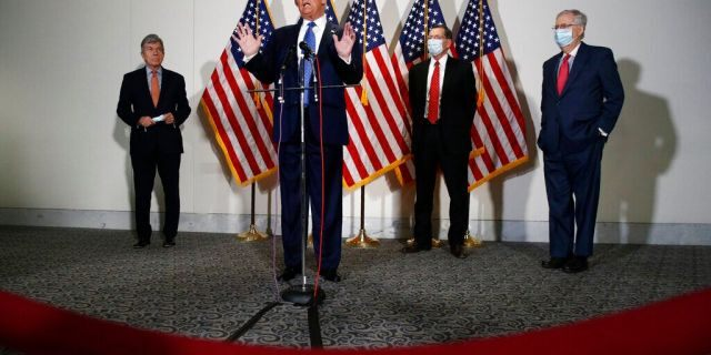 FILE: President Donald Trump speaks with reporters after meeting with Senate Republicans at their weekly luncheon on Capitol Hill in Washington.