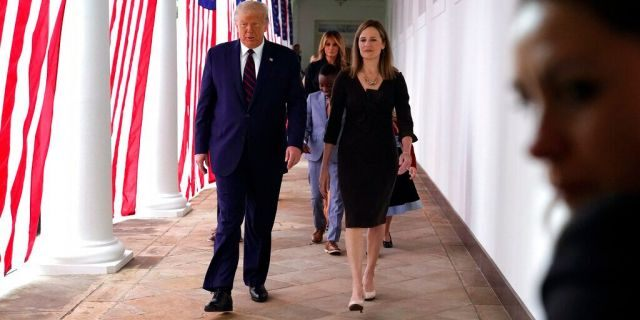 President Trump walks along the Colonnadewith Judge Amy Coney Barrett after a news conference to announce Barrett as his nominee to the Supreme Court, in the Rose Garden at the White House, Saturday, Sept. 26, 2020, in Washington. (AP Photo/Alex Brandon)