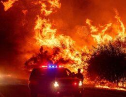 California firefighters battling wildfire face gusty winds, smoke dust devils