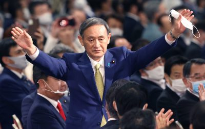Japan's Chief Cabinet Secretary Yoshihide Suga waves his hands after winning in the LDP (Liberal Democratic Party) presidential election at a hotel in Minato Ward, Tokyo on September 14, 2020. Prime Minsiter Shinzo Abe will leave the prime minister post for his health problem and a ruling party President election took place on the same day (Photo: Reuters/The Yomiuri Shimbun).