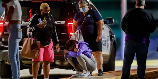 A woman kneels on the ground outside the University of Chicago Medicine's Comer Children's Hospital where a 8-year-old girl was taken after being killed in a shooting that wounded three others during the Labor Day weekend Monday Sep. 7, 2020 in Chicago. (Armando L. Sanchez/Chicago Tribune/Tribune News Service via Getty Images)