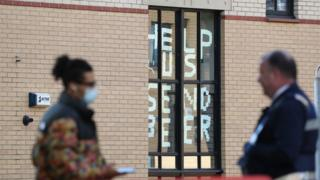 "A sign saying ""help us, send beer"" at Murano Street Student Village in Glasgow, where Glasgow University students are being tested at a pop up test centre."
