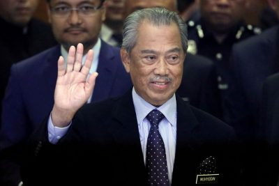 Malaysia's Prime Minister Muhyiddin Yassin waves to reporters before his cabinet announcement in Putrajaya, Malaysia, 9 March 2020 (Photo: Reuters/Lim Huey Teng).