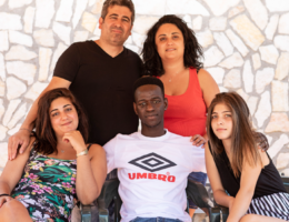 How a Gambian migrant found a new family in Italy