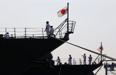 Japan Maritime Self-Defense Force personnel are seen on the destroyers JS Suzutsuki (DD 117) (L) and JS Inazuma (DD 105) as they arrive as part of an Indo-Pacific tour at Tanjung Priok Port in Jakarta, Indonesia, 18 September 2018 (Photo: Reuters/Willy Kurniawan).