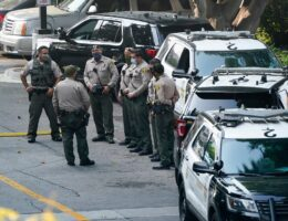 Los Angeles authorities in standoff with carjacking suspect amid reports of link to deputy ambush