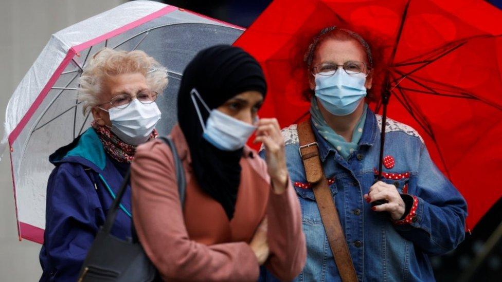People in masks in Blackburn