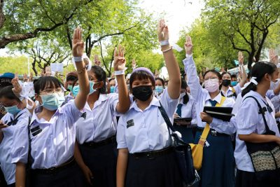 Anti-government protesters and students wearing white ribbons attend a demonstration demanding the government to resign, in front of the Ministry of Education in Bangkok, Thailand, 5 September 2020 (Photo: Reuters/Soe Zeya Tun).