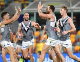 Port Adelaide clinches AFL minor premiership with win over Magpies