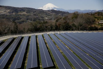Solar panels are seen at a solar power facility as snow covered Mount Fuji is background in Nakai town, Kanagawa prefecture, Japan, 1 March 2016 (Photo: Reuters/Issei Kato).