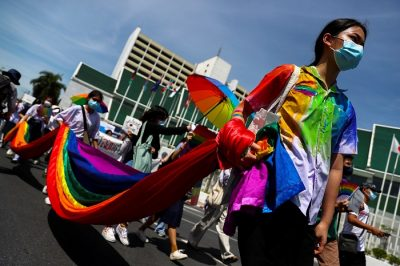 Members of a youth pride student group hold an LGBT flag during a rally for gender rights in Bangkok, Thailand 29 July, 2020 (Photo: Reuters/Athit Perawongmetha).