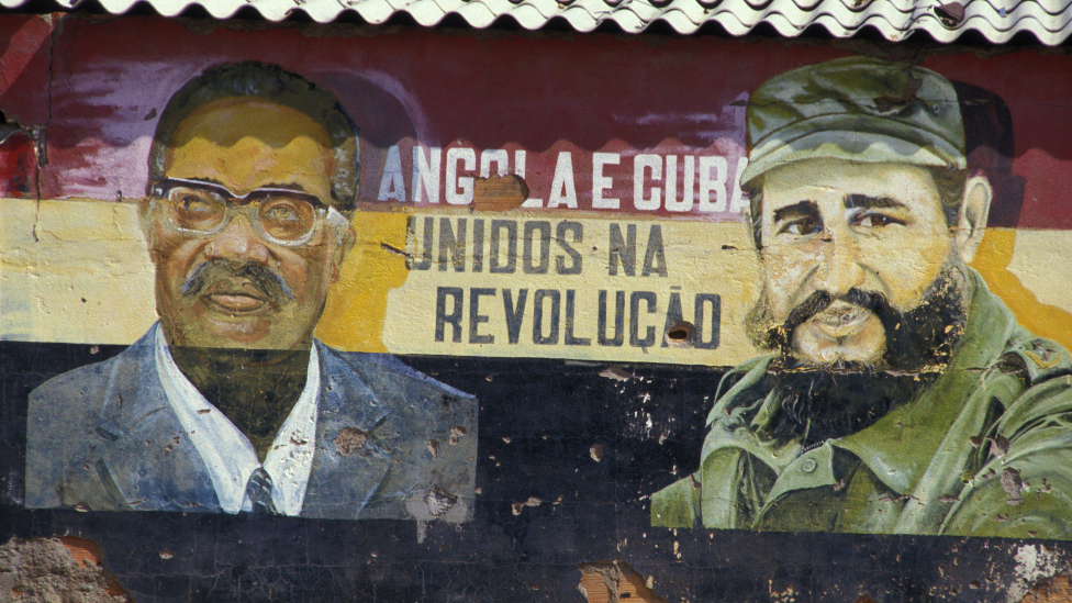 Graffiti in Angola in 1987 of Cuban leader Fidel Castro (R) and Angolan leader António Agostinho Neto (L)