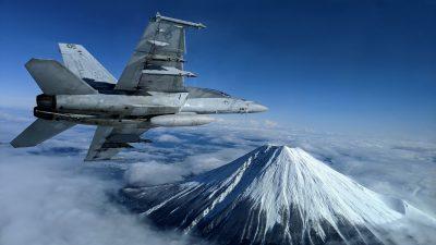 A US Navy F/A-18F Super Hornet flies past Mount Fuji, Japan, 29 January, 2020 (US Navy/Lt. Alex Grammar/Handout via Reuters).
