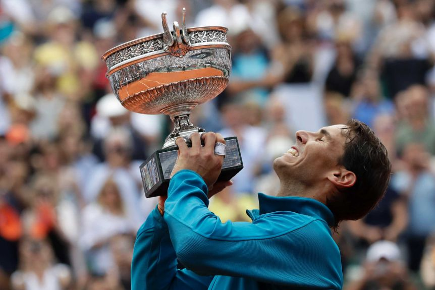 Rafael Nadal lifts the French Open trophy after beating Dominic Thiem in the final at Roland Garros