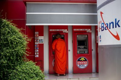 A monk withdraws money from an ATM in Vientiane, Laos (Photo: Reuters).