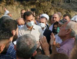Assad makes rare visit to areas hit by fires in west Syria