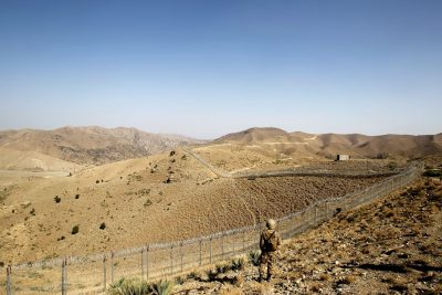 A Pakistani soldier stands guard along a border fence outside the Kitton outpost on the border with Afghanistan in North Waziristan, Pakistan, 18 October 2017 (Photo: Reuters/Caren Firouz).