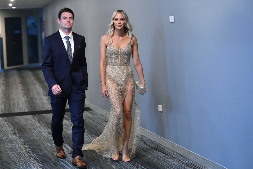 Lachie and Julie Neale walk into the Brownlow Medal ceremony at the Gabba.