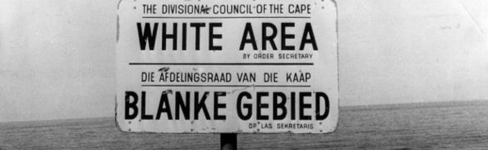 An apartheid notice on a beach near Capetown, denoting the area for whites only.