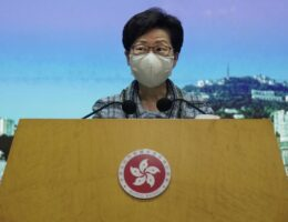 Hong Kong leader delays policy address until Beijing visit