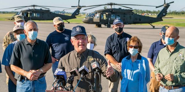 Louisiana Gov. John Bel Edwards talks about the devastation from Hurricane Delta after flying over the stricken areas in southwest Louisiana during a press conference at the airport Saturday Oct. 10, 2020, in Jennings, La.