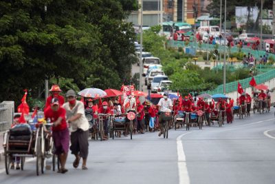 Trishaw drivers campaign for the National League for Democracy (NLD) party amid the coronavirus disease (COVID-19) spread, in Yangon, Myanmar, 10 September 2020 (Reuters/Shwe Paw Mya Tin).