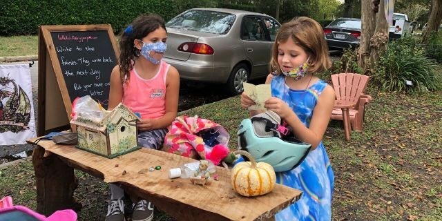 Maya Gebler and Cate Carroll read letters they've received from fairies in Norfolk, Va., on Monday Oct. 12, 2020.