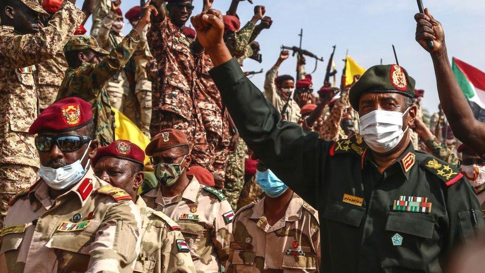 Sudan's Gen Burhan (R) visiting an air base in Omdurman in August 2020