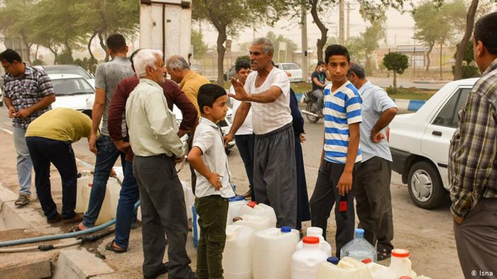 People waiting to fill up water containers
