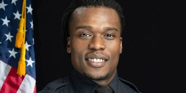 This undated photo provided by the Wauwatosa Police Department in Wauwatosa, Wis., shows Wauwatosa Police Officer Joseph Mensah. In a report released Wednesday, Oct. 7, 2020, an independent investigator recommended officials in the Milwaukee suburb fire Mensah, who has shot and killed three people in the last five years. (Gary Monreal/Monreal Photography LLC/Wauwatosa Police Department via AP)