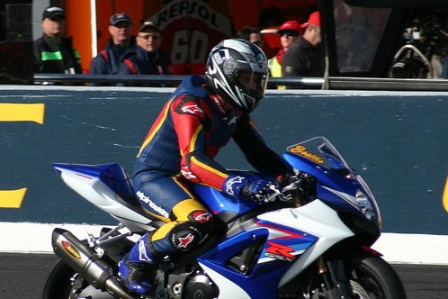 A man on a racing motorcycle.