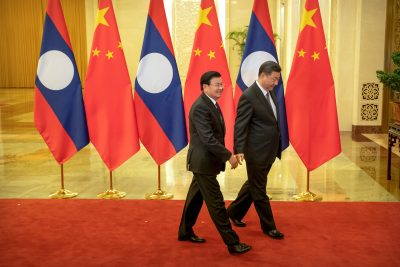 Laos' Prime Minister Thongloun Sisoulith and Chinese President Xi Jinping walk together before a meeting at the Great Hall of the People in Beijing, China, 6 January 2020 (Mark Schiefelbein/Pool via Reuters).