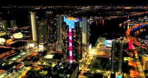 """Magic City"" Skyline Glows with Largest Electronic U.S. Flag 