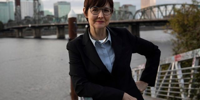 Portland Mayoral candidate Sarah Iannarone poses by the Willamette River. (AP Photo/Paula Bronstein, File)