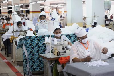 Bangladeshi garment workers make protective suit at a factory amid concerns over the spread of COVID-19 in Dhaka, Bangladesh, 31 March 2020 (Photo: Reuterd/Mohammad Ponir Hossain).