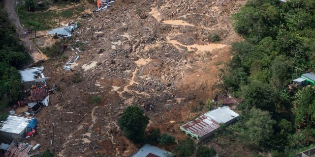 An aerial view of the massive, rain-fueled landslide in the village of Queja, in Guatemala, Saturday, Nov. 7, 2020, in the aftermath of Tropical Storm Eta.