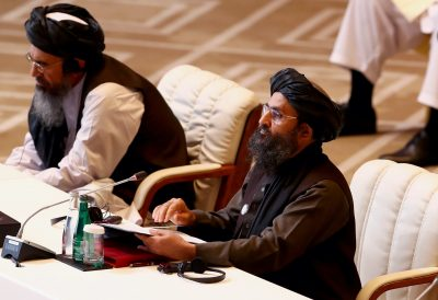 Mullah Abdul Ghani Baradar, the leader of the Taliban delegation, speaks during talks between the Afghan government and Taliban insurgents in Doha, Qatar, 12 September, 2020 (Photo: Reuters/Ibraheem al Omari).