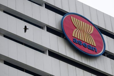 A bird flies near the Association of Southeast Asian Nations secretariat building, ahead of the ASEAN leaders' meeting in Jakarta, Indonesia, 23 April, 2021 (Photo: Reuters/Willy Kurniawan).