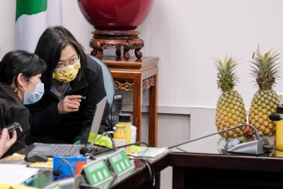 Taiwanese President and chairwoman of the DPP Tsai Ing-Wen, seen pointing at a pineapple during a press conference at the Democratic Progressive Party (DPP) office. In response to China's ban on exports of Taiwan-grown pineapples, the Taiwan government has been promoting local products based on home grown pineapples, Taipei, Taiwan, 3 March 2021 (Photo: Reuters).