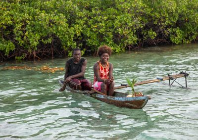 Couple on a canoe on water in Bougainville, Papua New Guinea. (Photo: Eric Lafforgue/Hans Lucas via Reuters).