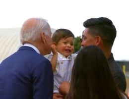 """Biden Scares a Baby in Colorado When He Leans in For His Signature """"Sniff and Kiss"""" (VIDEO)"""