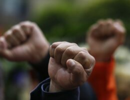 University Students Raise Their Fists Over COVID Restrictions — They Want Even More